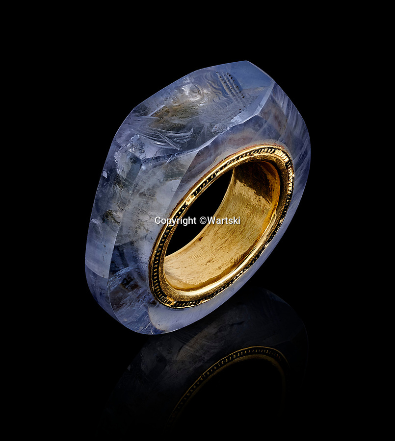 BNPS.co.uk (01202 558833)<br /> Pic: Wartski/BNPS<br /> <br /> 'Hololith' ring made from a single sapphire.<br /> <br /> Rock of Ages - Emperor Caligula's ring leads stellar exhibition at Royal Jewellers Wartski.<br /> <br /> A precious jewel, created for the most infamous of Rome's Emperor's nearly 2000 years ago, is causing gem collectors from around the world to flock to London as it goes on sale tomorrow.<br /> <br /> The exquisite solid sapphire hololith ring, a former star of the legendary collection of the 4th Duke of Marlborough in the 18th century, is thought to be valued at close to £500,000.<br /> <br /> The sky blue stone is etched with a portrait of his last wife, the notorious Caesonia, said to have been so beautiful that the depraved Emperor paraded her naked in front of his troops. <br /> <br /> She was played by Dame Helen Mirren in the controversial 1979 movie Caligula.<br /> <br /> The ring is the star attraction at a selling exhibition of over 100 engraved gems collected by Royal jewellers Wartski opening on Monday.<br /> <br /> The exhibition has sparked worldwide interest, with collectors from as far afield as Japan queueing outside their premises days before to be first through the door.