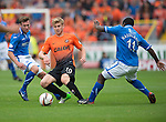 Dundee United v St Johnstone...24.08.13      SPFL<br /> Stuart Armstrong is closed down by Nigel Hasselbaink and Paddy Cregg<br /> Picture by Graeme Hart.<br /> Copyright Perthshire Picture Agency<br /> Tel: 01738 623350  Mobile: 07990 594431