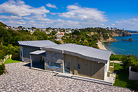 BNPS.co.uk (01202 558833)<br /> Pic: Rohrs&Rowe/BNPS<br /> <br /> Pictured: Seascape was built to replace an old 1950s bungalow and was designed to make the most of its spectacular setting. <br /> <br /> An exceptional contemporary clifftop home with panoramic views of not one, but two beaches is on the market for offers over £2m.<br /> <br /> Seascape is a brand new home, completed earlier this year and never lived in, that has a frontline spot next to Porthpean Beach and Duporth Beach.<br /> <br /> The sleek four-bedroom home in the village of Porthpean, Cornwall, has incredible sea views from almost every room, a full width balcony and a gate in the garden straight onto the South West Coast Path.
