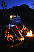 Sitting around the campfire at the Williwaw Campground, Portage Valley, Chugach National Forest, Alaska.