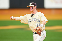 Wake Forest Demon Deacons second baseman Conor Keniry #14 makes a throw to first base against the Virginia Tech Hokies at Wake Forest Baseball Park on April 21, 2012 in Winston-Salem, North Carolina.  The Demon Deacons defeated the Hokies 8-6.  (Brian Westerholt/Four Seam Images)