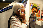 Cell lady, Art Basel. ....Art Basel invades Miami every year in December. This is it's fifth year in South Florida. Galleries from all around the world come to Miami to show their latest works. Over $100 million worth of art was sold during the week of December 7-10.