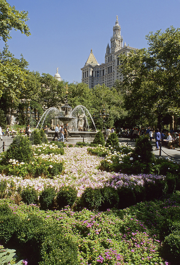 New York City, NY.  City Hall Park is an oasis in lowermost Manhattan. In background is the Municipal building