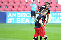 WASHINGTON, DC - NOVEMBER 8: Donovan Pines #23 of D.C. United celebrates his score with teammate Frederic Brilliant #13 of D.C. United during a game between Montreal Impact and D.C. United at Audi Field on November 8, 2020 in Washington, DC.