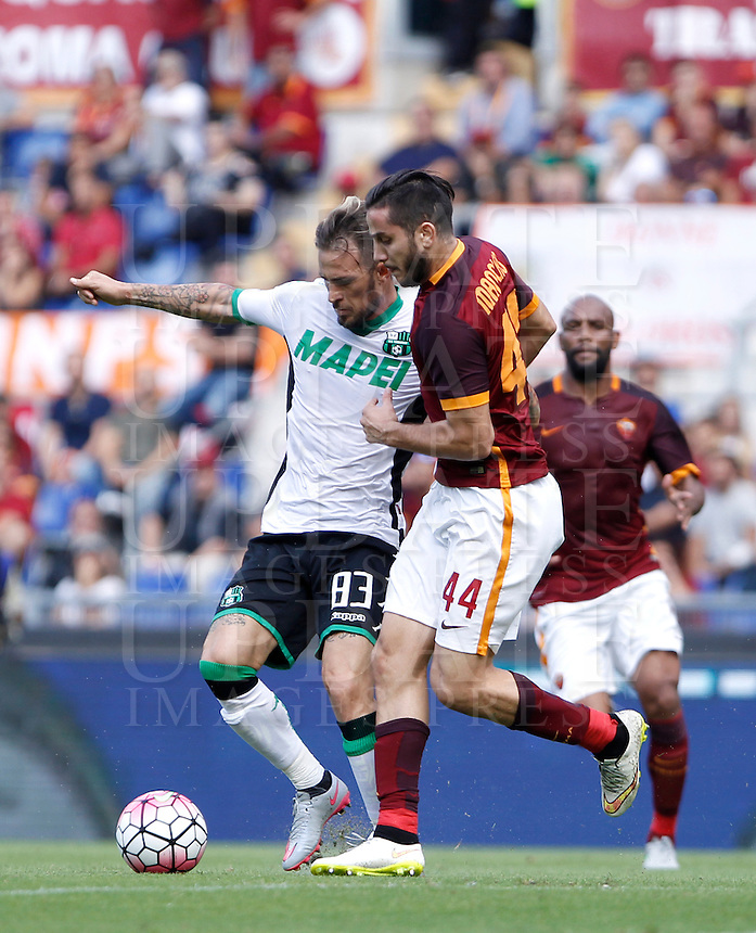 Calcio, Serie A: Roma vs Sassuolo. Roma, stadio Olimpico, 20 settembre 2015.<br /> Sassuolo's Antonio Floro Flores, left, and Roma's Kostas Manolas fight for the ball during the Italian Serie A football match between Roma and Sassuolo at Rome's Olympic stadium, 20 September 2015.<br /> UPDATE IMAGES PRESS/Isabella Bonotto