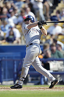 Phil Nevin of the San Diego Padres bats during a 2002 MLB season game against the Los Angeles Dodgers at Dodger Stadium, in Los Angeles, California. (Larry Goren/Four Seam Images)