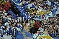 BOGOTA - COLOMBIA -21 -05-2015: Hinchas de Millonarios animan a su equipo durante el encuentro de ida entre Millonarios y Envigado FC por los cuartos de final de la Liga Águila I 2015 jugado en el estadio Nemesio Camacho El Campín de la ciudad de Bogotá./ Fans of Millonarios cheer their team during the first leg match between Millonarios and Envigado FC for the final quarters of the Aguila League I 2015 played at Nemesio Camacho El Campin stadium in Bogotá city. Photo: VizzorImage / Gabriel Aponte / Staff.