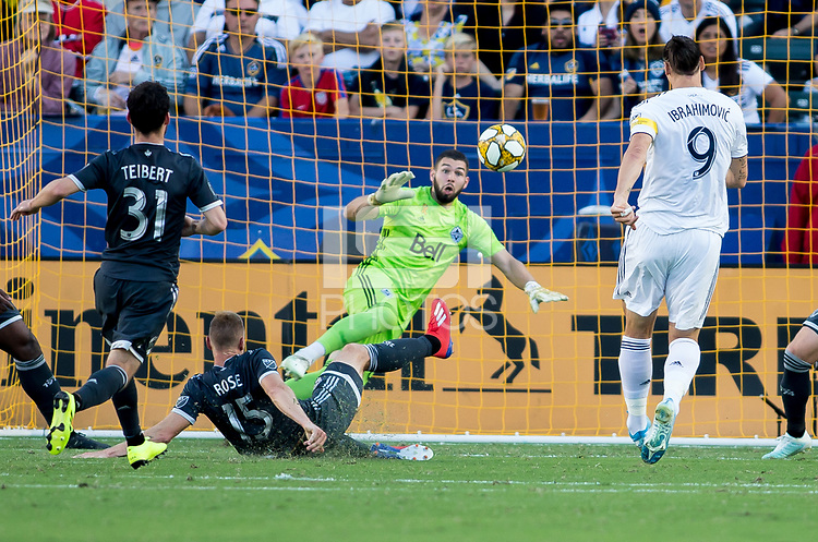CARSON, CA - SEPTEMBER 29: Zlatan Ibrahimovic #9 of the Los Angeles Galaxy takes a scoring shot on GK Maxime Crepeau #16 of the Vancouver Whitecaps moves with the ball during a game between Vancouver Whitecaps and Los Angeles Galaxy at Dignity Health Sports Park on September 29, 2019 in Carson, California.