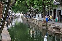 Suzhou, Jiangsu, China.  Canal Passing through Tongli Ancient Town near Suzhou.  A popular weekend tourist destination.