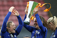 14th March 2021; Vicarage Road, Watford, Herts;  Melanie Leupolz  8 Chelsea and Erin Cuthbert  22 Chelsea, right celebrate their victory with teammates during the trophy ceremony after the FA Womens Continental Tyres League Cup final game between Bristol City and Chelsea at Vicarage Road Stadium in Watford.
