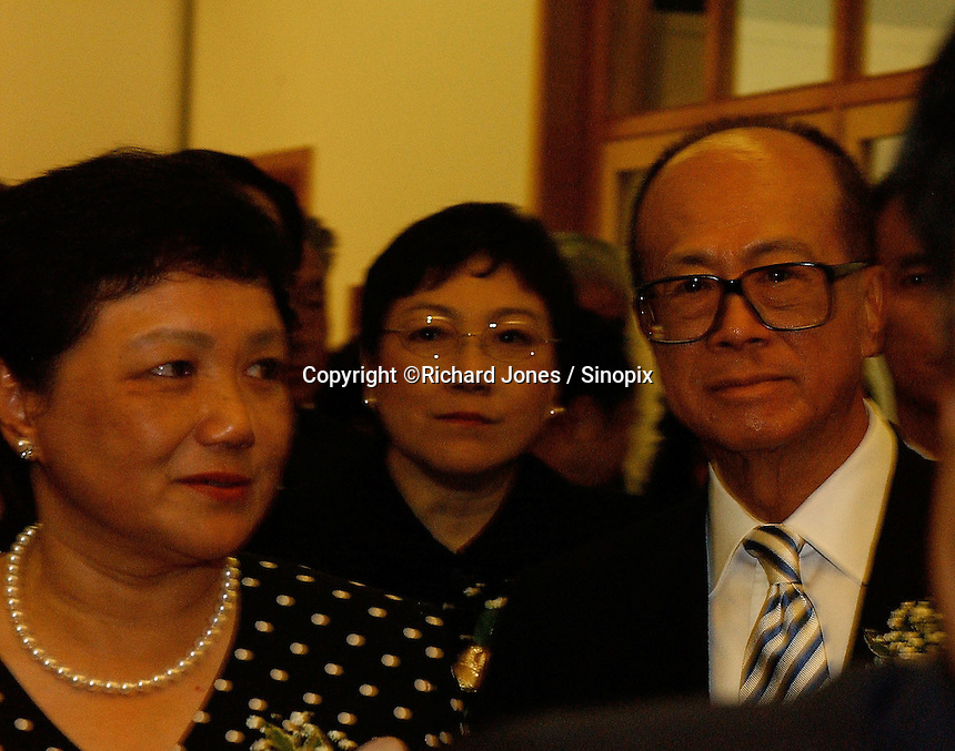 """Li Ka Shing (right) together with Deng's daughters, Deng Nan (left) and Deng Rong (middle) at the opening ceremony of """"Giant of the Century"""" - an exhibition to commemorate the 100th Anniversary of the Birth of Deng Xiaoping in Hong Kong. The exhibition aims at introducing Deng's life to the people of Hong Kong.<br /> 26-AUG-04"""