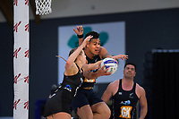 NZ Men's Jake Schuster beats Kelly Jury to the ball during the Cadbury Netball Series match between NZ Silver Ferns and NZ Men at the Fly Palmy Arena in Palmerston North, New Zealand on Thursday, 22 October 2020. Photo: Dave Lintott / lintottphoto.co.nz