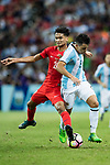 Marcos Acuna of Argentina (R) fights for the ball with Safuwan Baharudin of Singapore (L) during the International Test match between Argentina and Singapore at National Stadium on June 13, 2017 in Singapore. Photo by Marcio Rodrigo Machado / Power Sport Images