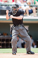 Home plate umpire Jon Byrne makes a strike call during the International League game between the Louisville Bats and the Charlotte Knights at Knights Stadium on July 17, 2011 in Fort Mill, South Carolina.  The Knights defeated the Bats 7-6.   (Brian Westerholt / Four Seam Images)