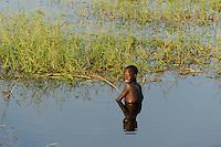 SOUTH SUDAN Lakes state Rumbek, boy catching fish in swamp / SUED SUDAN, Junge angelt im Sumpf