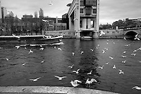 A cargo boat travels upstream on the Seine river toward the Pont de Bercy in Paris, France, three days after coordinated terrorist attacks struck the heart of the French capital. Economic activity across the city, including river traffic showed signs of resilience.