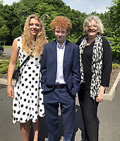 """Pictured L-R: Eve Stewart, Jake and Rachel Stewart, two of Pat Stewart's grandchildren and her daughter respectively.<br /> Re: The funeral of Pat Stewart at the Cardiff and Glamorgan Memorial Park and Crematorium, Wales, UK. Pat Stewart became famous as """"the girl in the spotty dress"""" after an iconic image taken by Bert Hardy in Blackpool in 1951."""