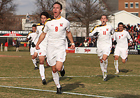 Teammates of the University of Maryland follow Jason Herrick #9 after he scored the second goal during an NCAA quarter-final match against the University of Michigan at Ludwig Field, University of Maryland, College Park, Maryland on December 4 2010.Michigan won 3-2 AET.