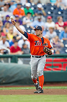 Cal State Fullerton Titans third baseman Jerrod Bravo (12) makes a throw to first base during the NCAA College baseball World Series against the Vanderbilt Commodores on June 14, 2015 at TD Ameritrade Park in Omaha, Nebraska. The Titans were leading 3-0 in the bottom of the sixth inning when the game was suspended by rain. (Andrew Woolley/Four Seam Images)