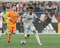 FOXBOROUGH, MA - JUNE 29: Juan Agudelo #17 brings the ball forward during a game between Houston Dynamo and New England Revolution at Gillette Stadium on June 29, 2019 in Foxborough, Massachusetts.