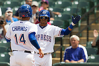 Round Rock Express outfielder Engel Beltre #7 greets tea mate Robinson Chriinos #14 as he scores a run against the New Orleans Zephyrs in the Pacific Coast League baseball game on April 21, 2013 at the Dell Diamond in Round Rock, Texas. Round Rock defeated New Orleans 7-1. (Andrew Woolley/Four Seam Images).
