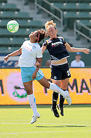 Chioma Igwe #12 of the Chicago Red Stars attempts to get a loose ball over Camille Abily #20 of the Los Angeles Sol during their WPS game at The Home Depot Center on June 27,2009 in Carson, California.  The Sol defeated the Red Stars 4-0.