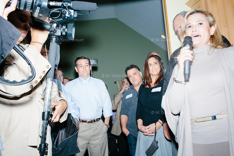 """Heidi Nelson Cruz, wife of Texas senator and Republican presidential candidate Ted Cruz, speaks to attendees at an event called """"Smoke a cigar with Ted Cruz"""" at a house party at the home of Linda & Steven Goddu Salem, New Hampshire."""