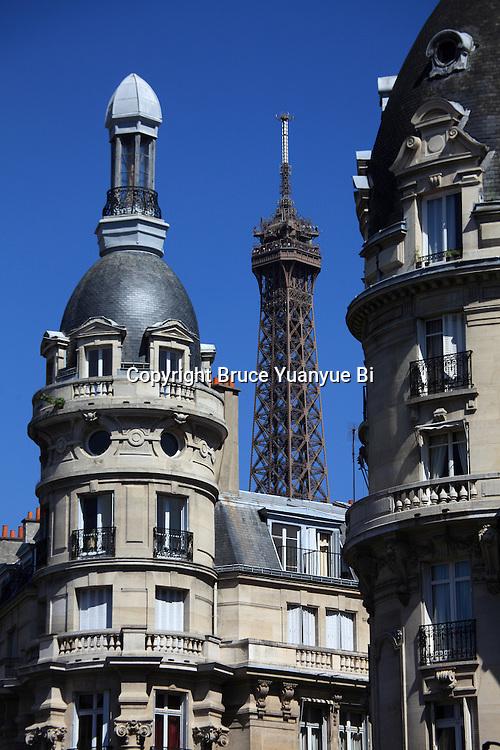 Apartment buildings with Eiffel Tower La tour eiffel in the back. City of Paris. Paris. France