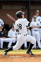 Right fielder Cody Brittain (18) of the University of South Carolina Upstate Spartans smacks a home run in the first inning of a game against the Winthrop University Eagles on Wednesday, March 4, 2015, at Cleveland S. Harley Park in Spartanburg, South Carolina. Upstate won, 12-3. (Tom Priddy/Four Seam Images)