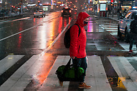 NEW YORK, NEW YORK - JANUARY 31: A man walks around Times Square during the pass of the snowstorm on January 31, 2021 in New York City. New York City Mayor Bill de Blasio declared a state of emergency order due to the arriving storm that's expected to wallop New York, where airports are expected to cancel the majority if their flights. (Photo by Eduardo MunozAlvarez/VIEWpress)