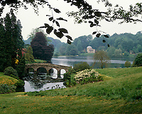 The Palladian Bridge and the Pantheon seen from across the great lake at the National Trust gardens of Stourhead in England
