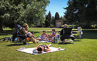 HIGH WYCOMBE, BUCKINGHAMSHIRE, England - 29.05.2020<br /> .<br /> People enjoy the summer weekend sun by relaxing in the RYE park, as the government lockdown is due to be relaxed further on Monday including allowing groups of 6 to meet up as the COVID-19 pandemic continues in High Wycombe, Bucks on 29 May 2020. Photo by Andy Rowland.