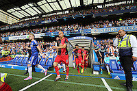 Pictured L-R: Chelsea and Swansea teams exit the tunnel, led by Andre Schurrle and Jonjo Shelvey. Saturday 13 September 2014<br /> Re: Premier League Chelsea FC v Swansea City FC at Stamford Bridge, London, UK.