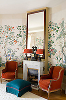 The furniture grouped around the fireplace in the guest bedroom are taken from the contemporary Chinese wallpaper