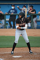 Dariel Gomez (43) of the Modesto Nuts bats against the Rancho Cucamonga Quakes at LoanMart Field on May 12, 2021 in Rancho Cucamonga, California. (Larry Goren/Four Seam Images)
