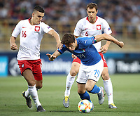 Football: Uefa under 21 Championship 2019, Italy -Poland, Renato Dall'Ara stadium Bologna Italy on June19, 2019.<br /> Italy's Federico Chiesa (c) in action with Poland's Patryk Dziczek (l) and Krystian Bielik (r) during the Uefa under 21 Championship 2019 football match between Italy and Poland at Renato Dall'Ara stadium in Bologna, Italy on June19, 2019.<br /> UPDATE IMAGES PRESS/Isabella Bonotto