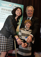 MONTREAL, CANADA - File Photo - Line Beauchamps, Education Minister and Quebec Premier Jean Charest  against intimidation and bullying in schools,  in 2012