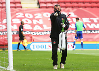 A member of the Charlton ground staff notices that a ball has not been disinfected after being retrieved from the stand during Charlton Athletic vs Reading, Sky Bet EFL Championship Football at The Valley on 11th July 2020