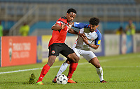 Couva, Trinidad & Tobago - Tuesday Oct. 10, 2017: Nathan Lewis, DeAndre Yedlin during a 2018 FIFA World Cup Qualifier between the men's national teams of the United States (USA) and Trinidad & Tobago (TRI) at Ato Boldon Stadium.