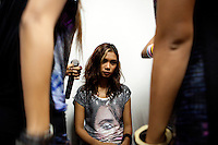 Ah Moon, one of the 'Me N Ma Girls', Myanmar's first girl band, calms her nerves before going on stage at a private functions in a hotel in Yangon. The band's members were recruited by Australian dancer Nicole May. They sing and dance in the manner of many Western pop acts but in socially conservative Myanmar, they represent a radical break from the norm.
