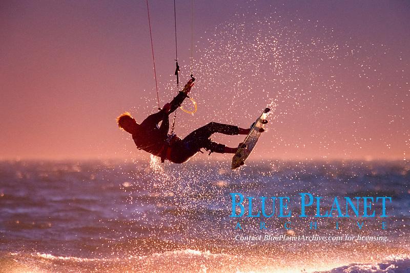 Peter Scheibel performs a high jump on a kiteboard, Waddell Creek, Big Basin Redwood State Park, north of Santa Cruz, California, USA, East Pacific Ocean