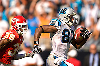 Carolina Panthers wide receiver Muhsin Muhammad (87) runs the ball past Kansas City Chiefs cornerback Brandon Carr (39) during a NFL football game at Bank of America Stadium in Charlotte, NC.