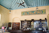 Decorative coffee shop sign above an alcohol stocked bar, Cienfuegos, Cuba.