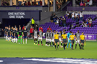 ORLANDO, FL - JANUARY 31: Starting XI from both teams take the field prior to a game between Trinidad and Tobago and USMNT at Exploria stadium on January 31, 2021 in Orlando, Florida.