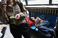 CHINA. Beijing. A man sleeping inside Beijing West Train Station. 2007.