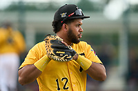 FCL Pirates Gold catcher Darwin Baez (12) warms up in between innings during a game against the FCL Red Sox on July 1, 2021 at Pirate City in Bradenton, Florida.  (Mike Janes/Four Seam Images)