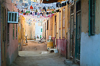 Narrow street decorated in preparation for Ramadan, Al-Qusair, Egypt.