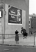Two teenage girls and a cigarette advertisement, Harrow Road, North Paddington, London.