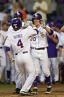 LSU Tigers shortstop Alex Bregman #30 and outfielder Mark Laird #9 celebrate with teammate Raph Rhymes #4 after his first inning home run against the Auburn Tigers in the NCAA baseball game on March 22nd, 2013 at Alex Box Stadium in Baton Rouge, Louisiana. LSU defeated Auburn 9-4. (Andrew Woolley/Four Seam Images).