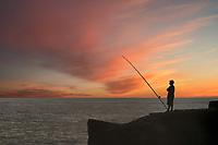 Fisherman and sunrise. The Puna Coast, Hawaii.